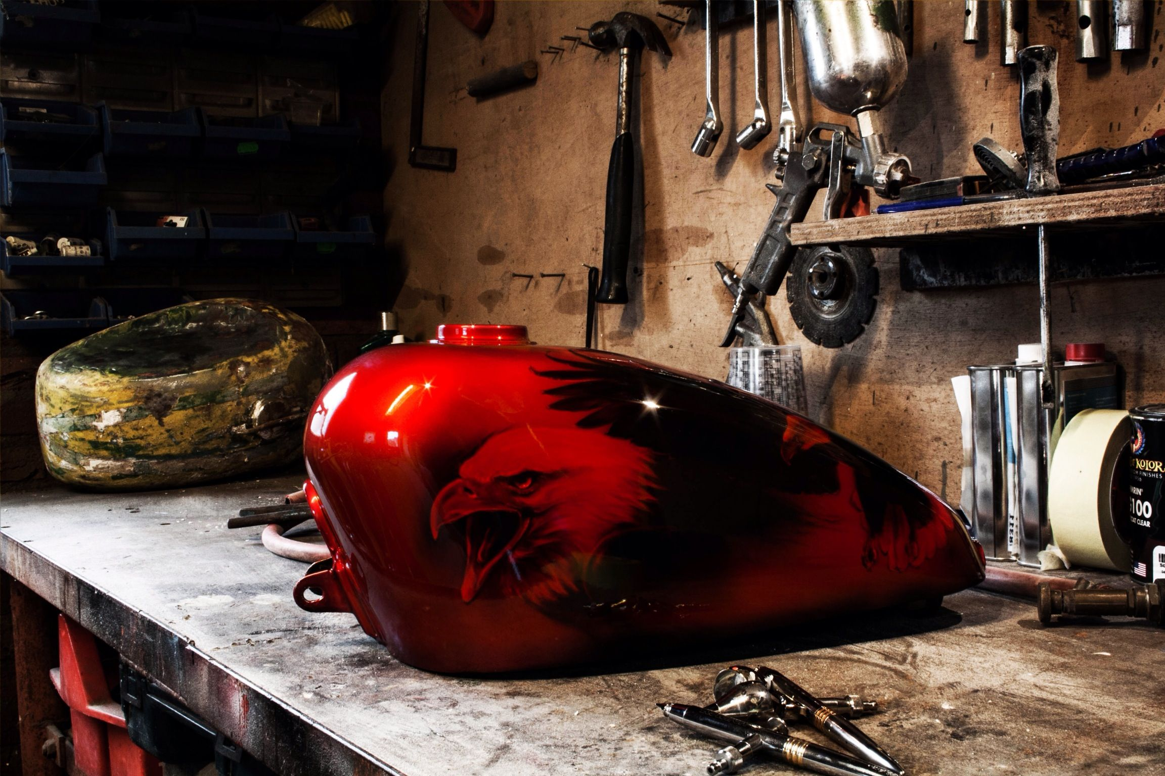 2012 - An harley davidson sportster tank i did for myself, it will only be used as a display piece.. The airbrush and the red kandy are all house of kolor paints.