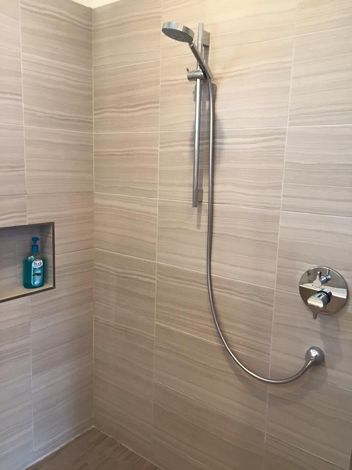 A simple, modern bathroom with porcelain tile & Hansgrohe USA ...