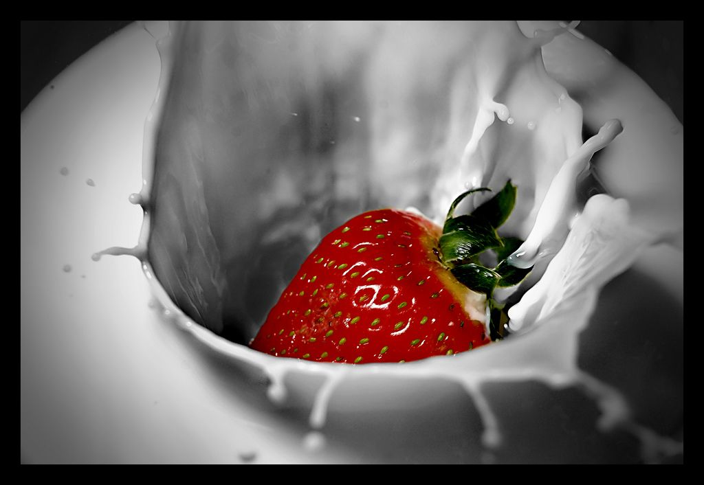 Most of the appeal from this photo comes from the red strawberry with that bright red the emphasis of the photo is centered