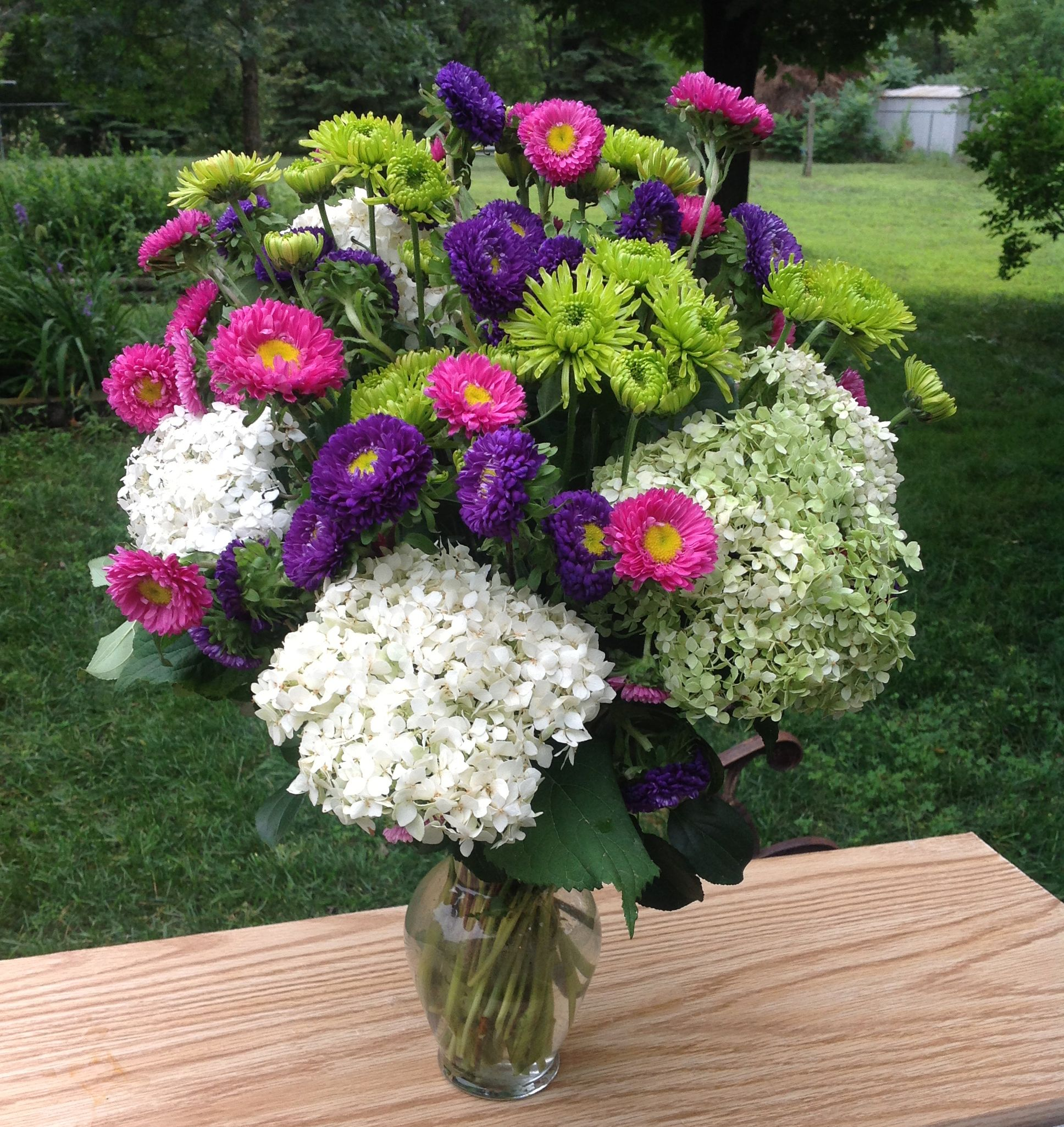 Lovely Arrangement Using Hydrangea Asters And Lime Green Daisies