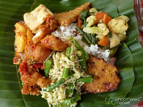 A mouthwatering plate of traditional Balinese food presented on banana leaves.