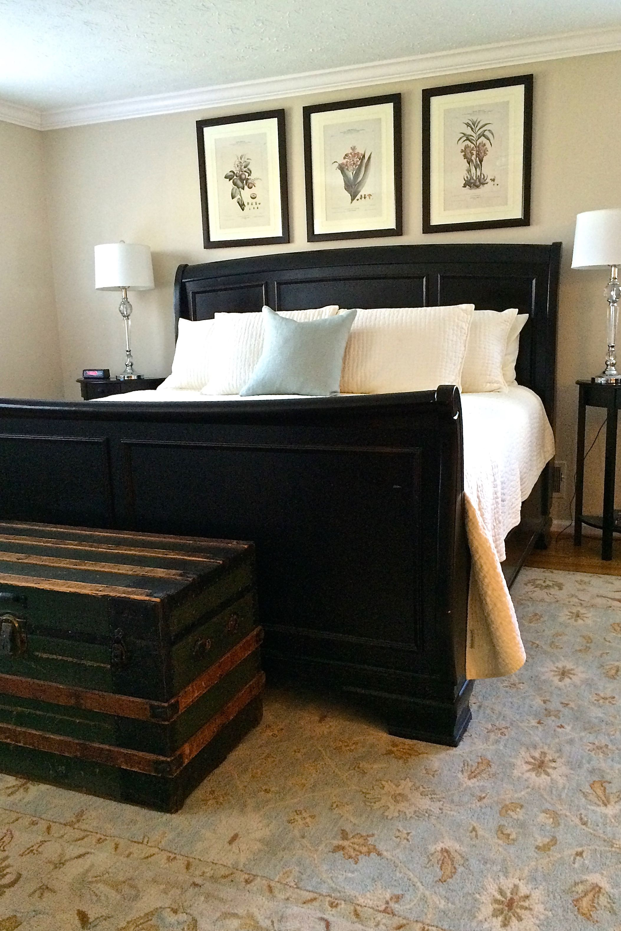Master Bedroom with a jet black sleigh bed from Pottery