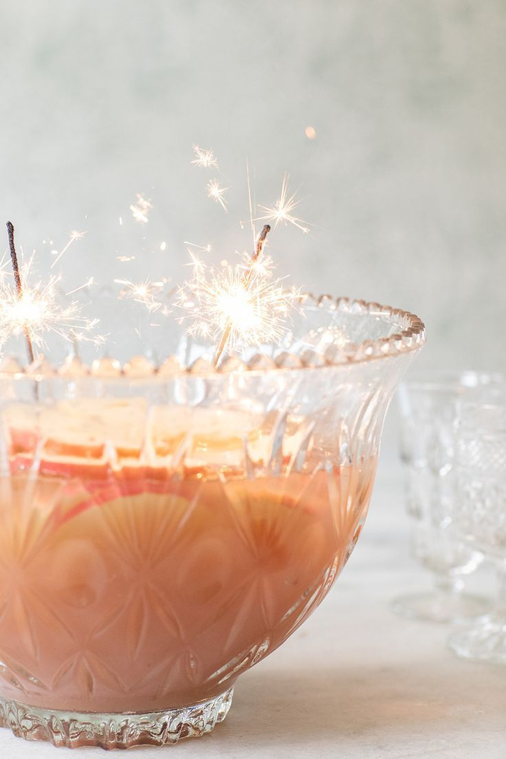 Spiced Apple Sparkling Holiday Punch -  Nothing sparkles more than this festive punch recipe! It's spiked with apple vodka, sparkling white Champagne and two varieties of apple cider! Truly one of the best holiday punches and great for Christmas, New Year's Eve or and winter party #punch #cocktailrecipes #entertaining #newyearseve #christmas #party