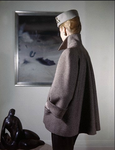 herringbone high-collared jacket with wide cuffs, photo Clifford Coffin