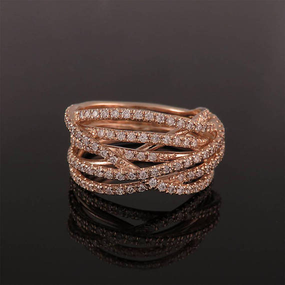 A stunning rose gold and diamonds ring Solid gold interweaving