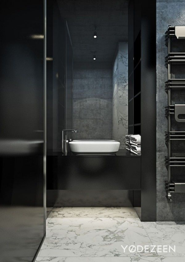 A dark and calming bachelor bad with natural wood and concrete concrete marble bathroom floor and woods