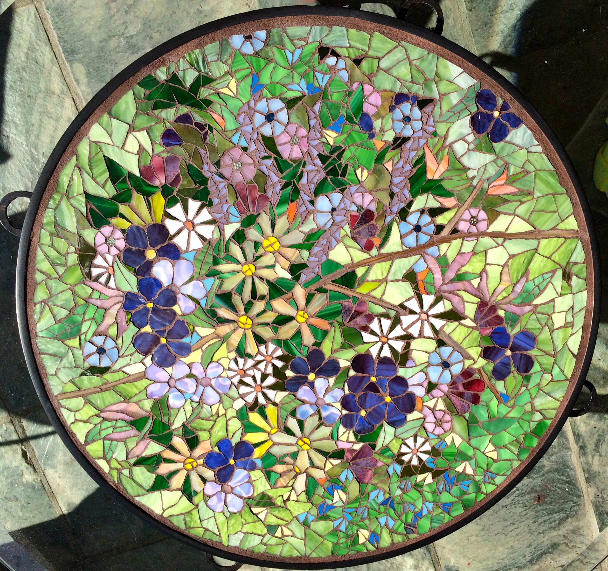 24 inch mosaic table top commissioned to sit on a fire pit when