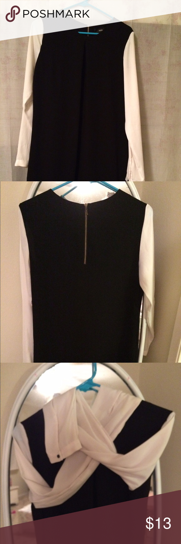 Beautiful color block dress! Never worn, excellent condition! Black and white work dress! Love the black buttons on sleeves! Classy dress!!! Hits at the knees /I'm 5'6. Dresses Midi