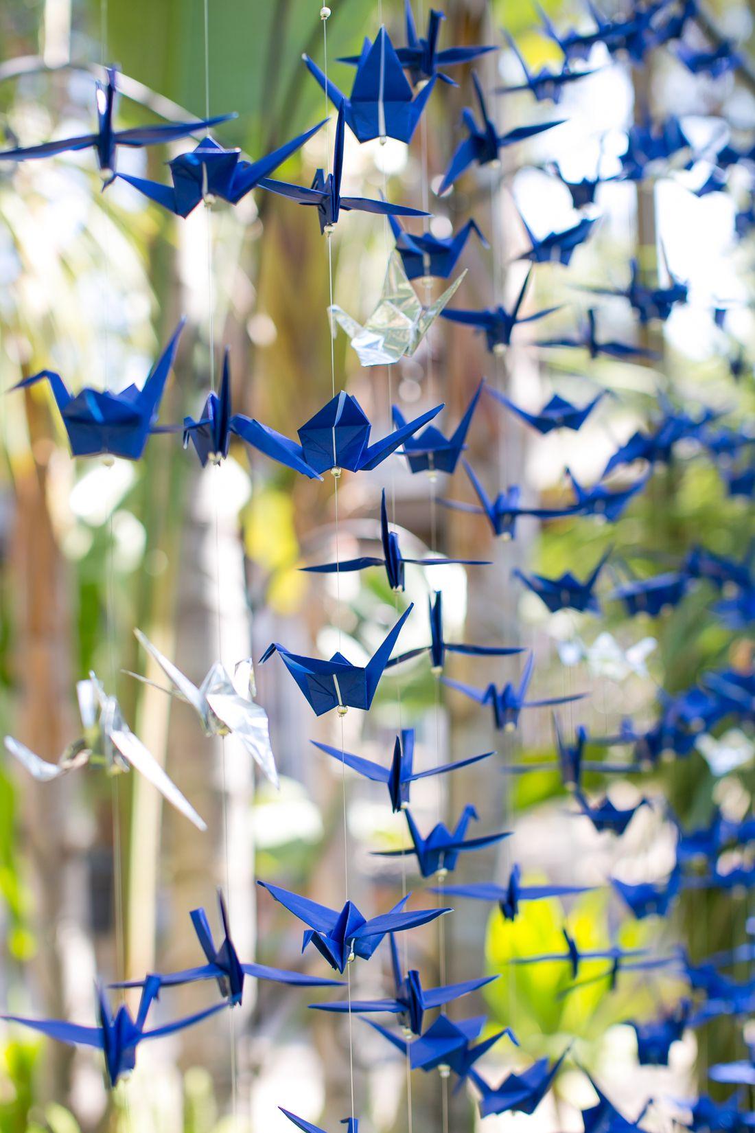 Ceremony backdrop idea of handing paper cranes  Blue Wedding Story