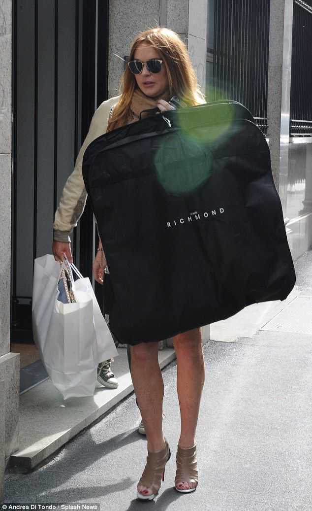 T'il you drop: Lohan threw a jacket over the outfit and took to the streets, where she spo...