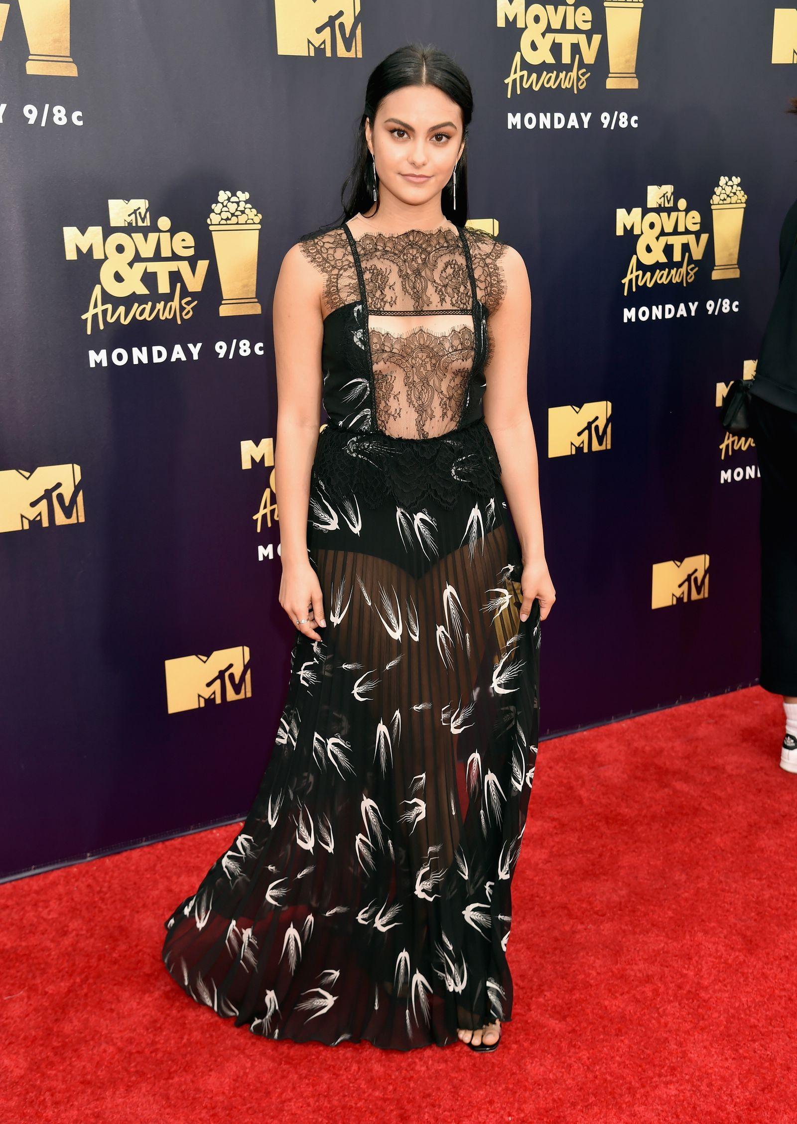 558cde63 Camila Mendes wearing an sheer embroidery bodice and a see thru printed  skirt at the MTV Movie & TV Awards 2018