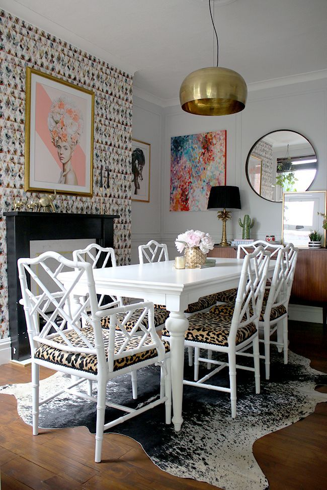 Eclectic Glam Living Room With Graphic Feature Wallpaper Leopard Print Chairs Black And Marble