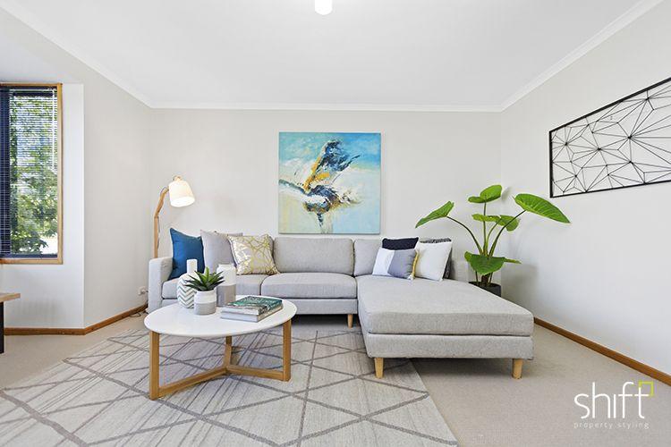 beachside living, coastal style, neutral sofa, large canvas art