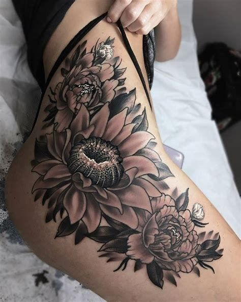 Photo of Flower Tattoo Up Thigh