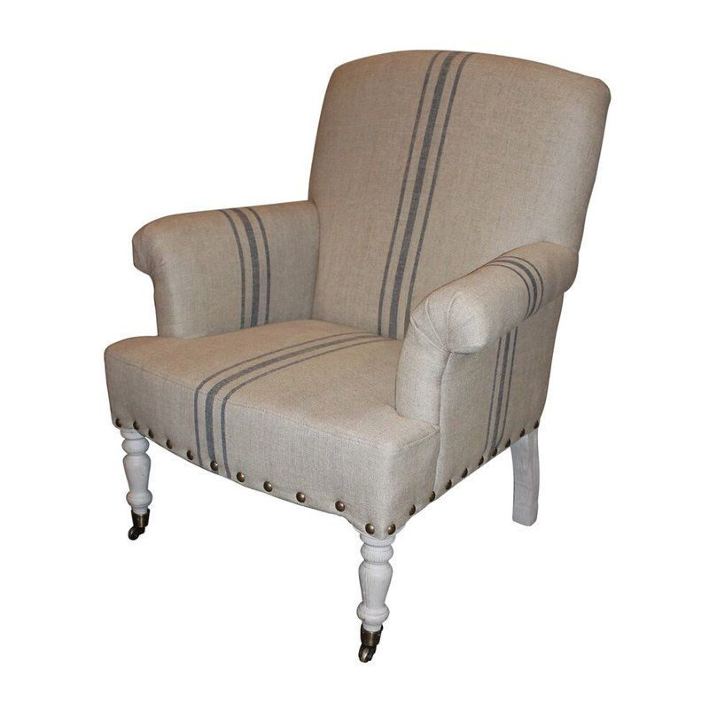 Classic style arm chair has a hardwood frame and turned