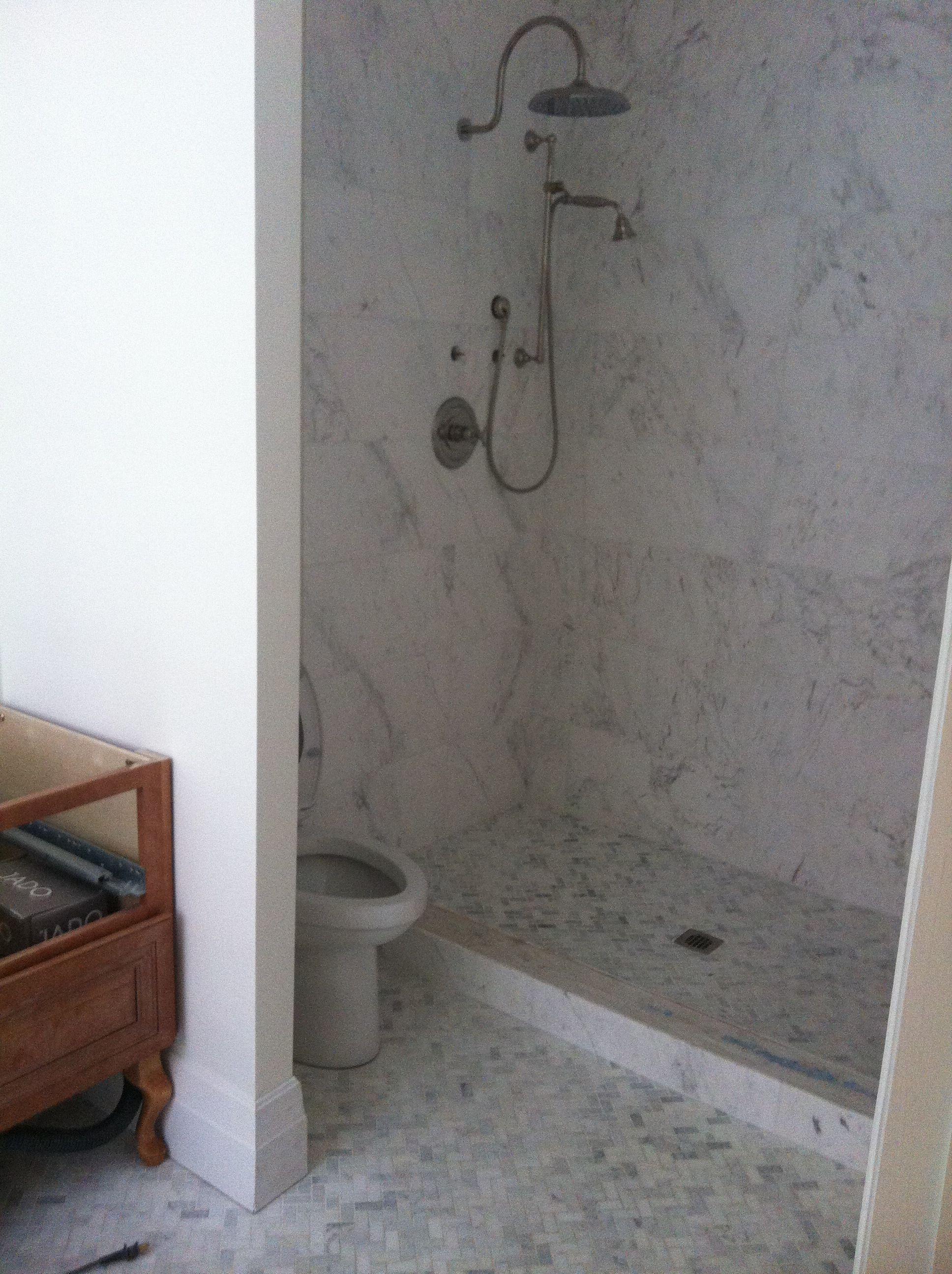 Master bathroom,q Ajax marble wall tile, Carrara herringbone floor tile.