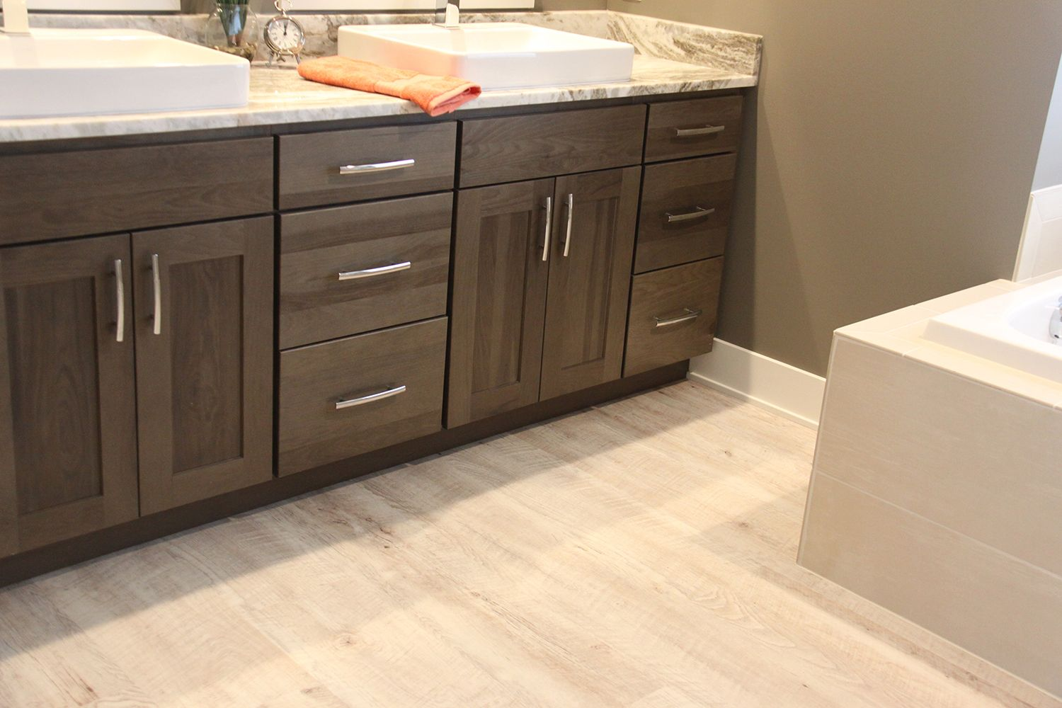 Luxury Vinyl Plank Flooring With Dark Shaker Cabinets In Bathroom   Degraaf  Interiors