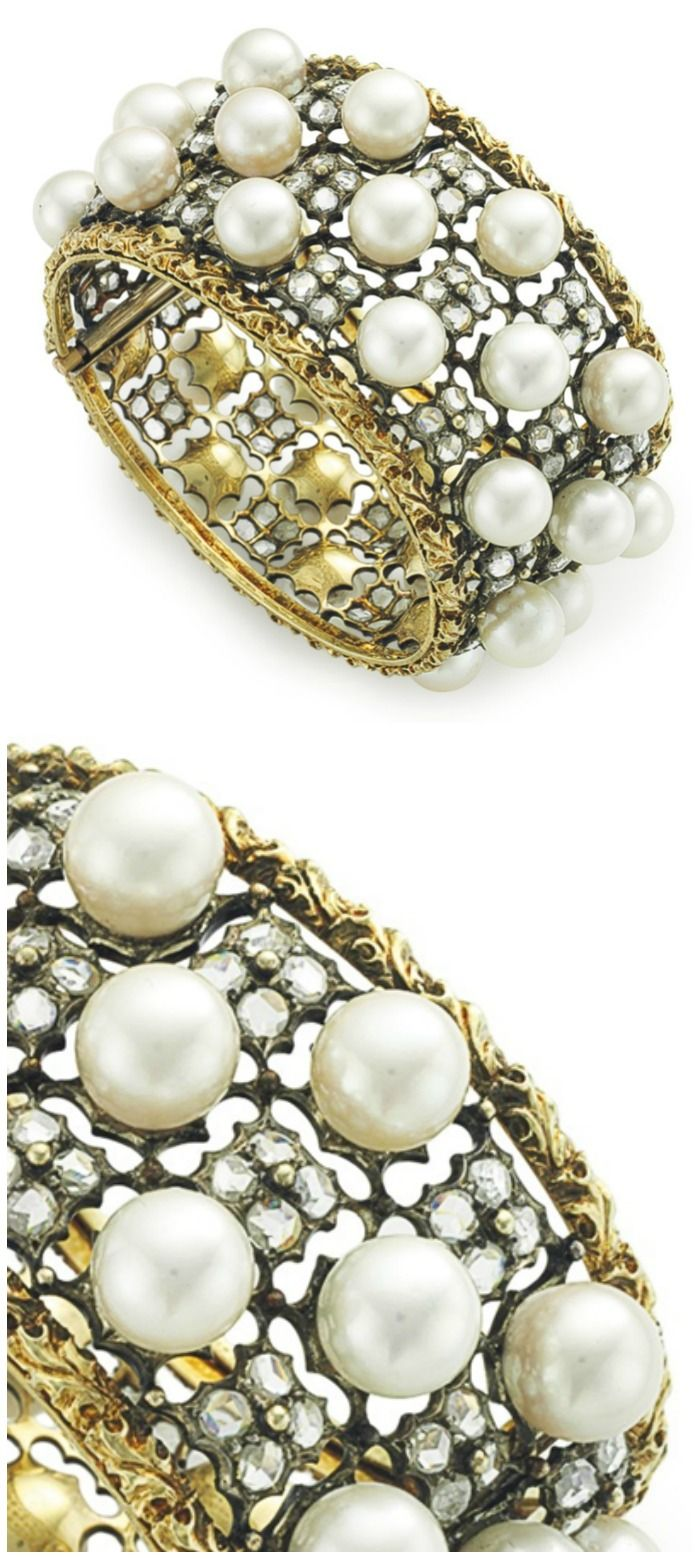 A DIAMOND AND CULTURED PEARL BANGLE BRACELET, BY BUCCELLATI: Designed as three rows of alternating rose-cut diamond florets and cultured pearls, measuring from approximately 9.30 to 8.90 mm, to the pierced silver openwork frame, within a gold foliate trim, 6 1/2 ins., mounted in 18k gold and silver, in a Buccellati taupe case. Signed Buccellati.   Via Christie's.