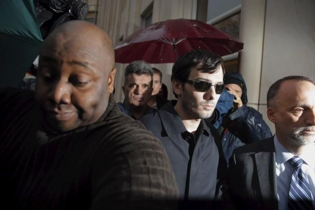Martin Shkreli (C), chief executive officer of Turing Pharmaceuticals and KaloBios Pharmaceuticals Inc, departs the U.S. Federal Court after an arraignment following him being charged in a federal indictment filed in Brooklyn relating to his management of hedge fund MSMB Capital Management and biopharmaceutical company Retrophin Inc. in New York December 17, 2015. REUTERS/Lucas Jackson/ Couldnt have happened to a nicer guy