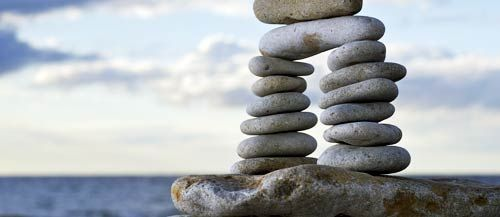 Principles Of Design Balance : Balance different sized rocks are stacked on each other