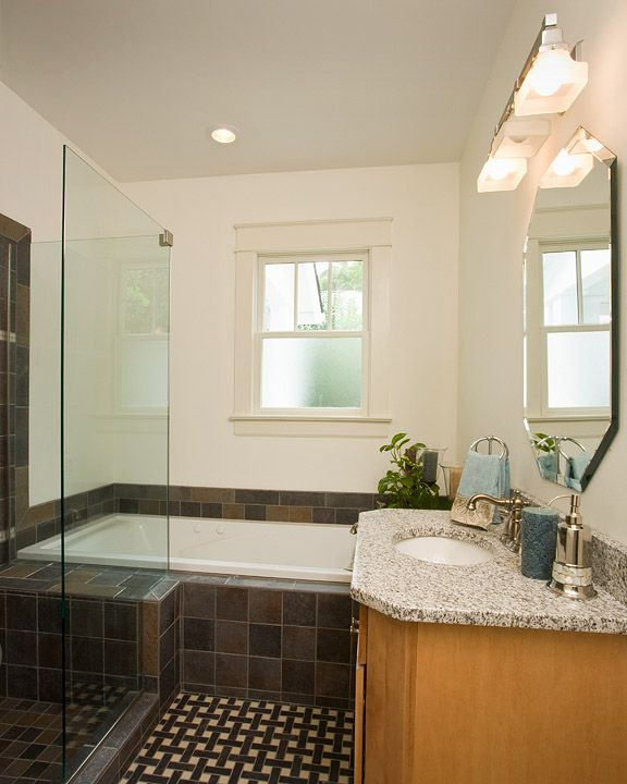 A guest bathroom in a historic home remodel  Photos by Ray Strawbridge Commercial Photography