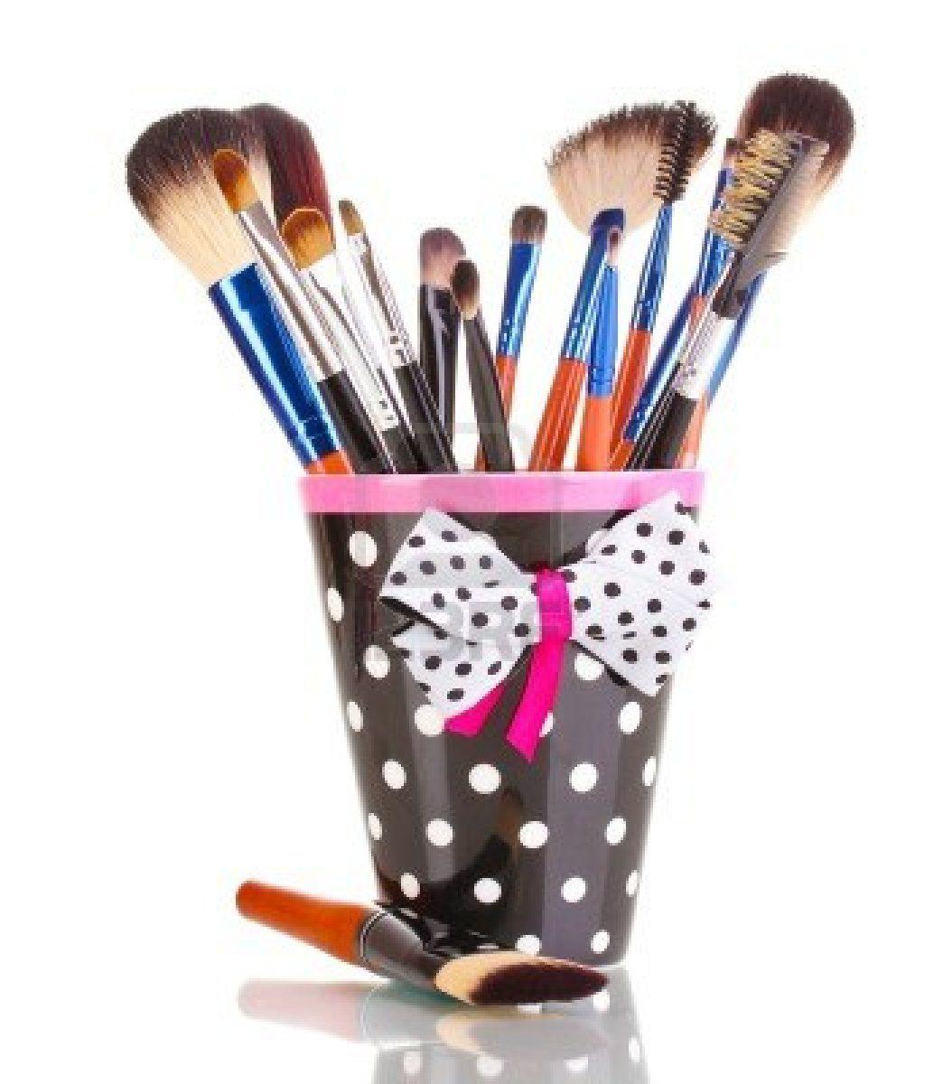 Cute polka dot mug for makeup brushes.
