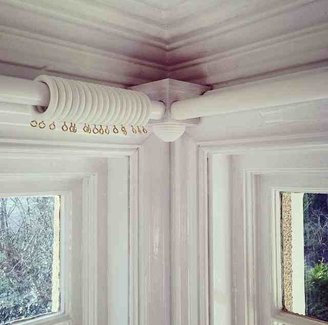 corner bracket for curtain poles in bay window