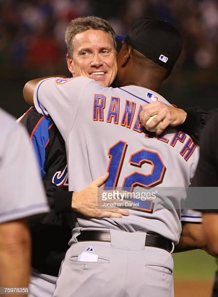 Pitcher Tom Glavine Of The New York Mets Hugs Manager