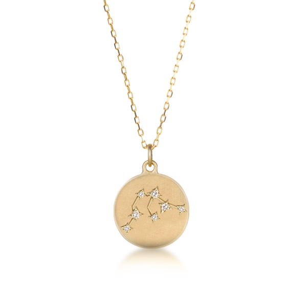 Solid 14k gold round disc featuring zodiac constellations punctuated with sparkly natural white diamonds. Each sign is hand engraved and handset diamonds with star settings. The surface is brushed matte finish to create more contrast between hand engraved sign and the pendant top, create an illusion to make the details