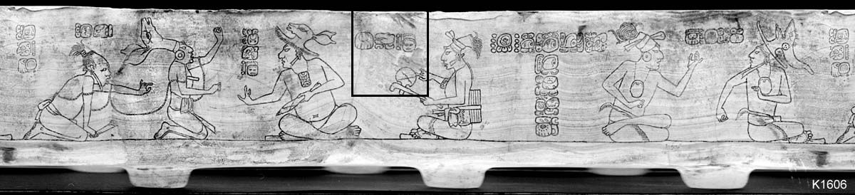 An incised stone vessel, two bound captives, left, sit before a knife-wielding lord, behind whom--within a partially restored section--an executioner provocatively shows off the sharpness of his axe.