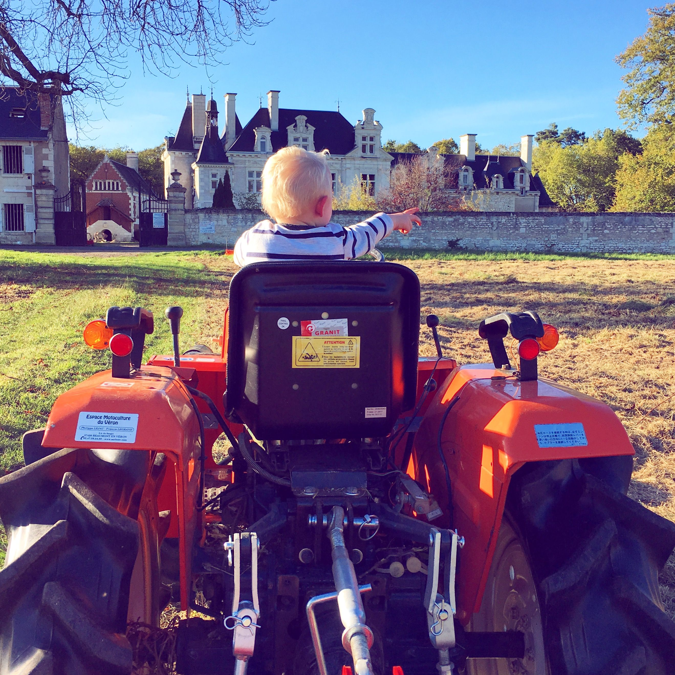 My little farmer giving directions. As a backdrop, beautiful chateau ...