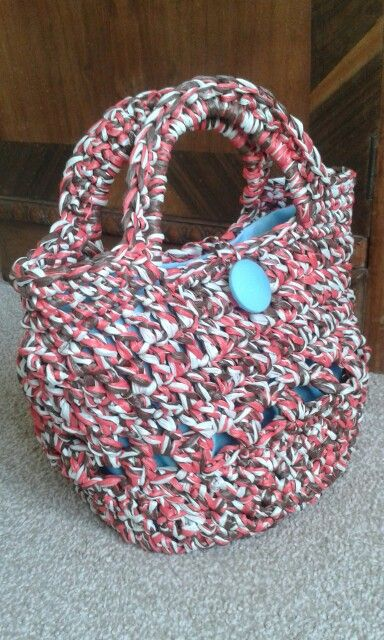 Cute little crocheted bag. Made with three strands of raffia.  No pattern. Made it up as I went along after starting with a flat circle.