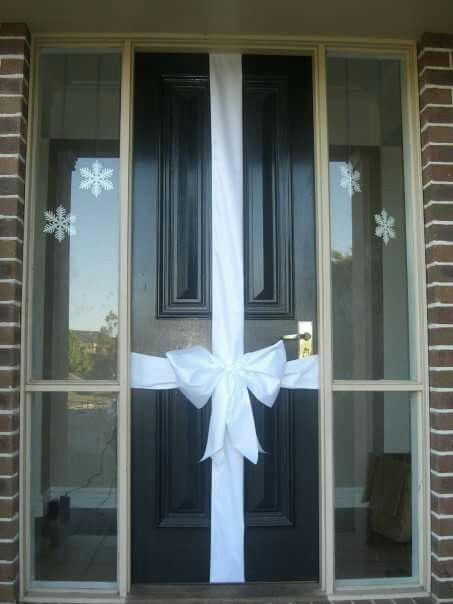 White Christmas With White Bows Gift Wrapped Front Door