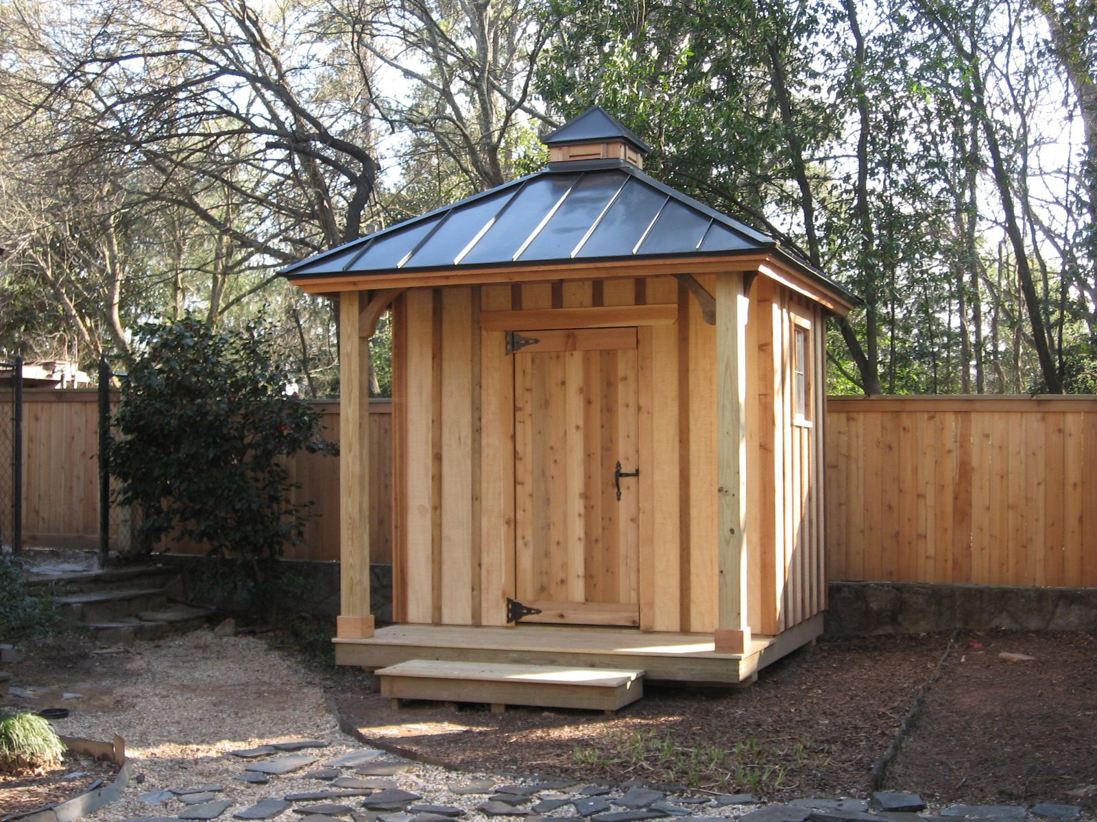 Simple tool shed with privacy fence designed and built by for Simple garden shed designs