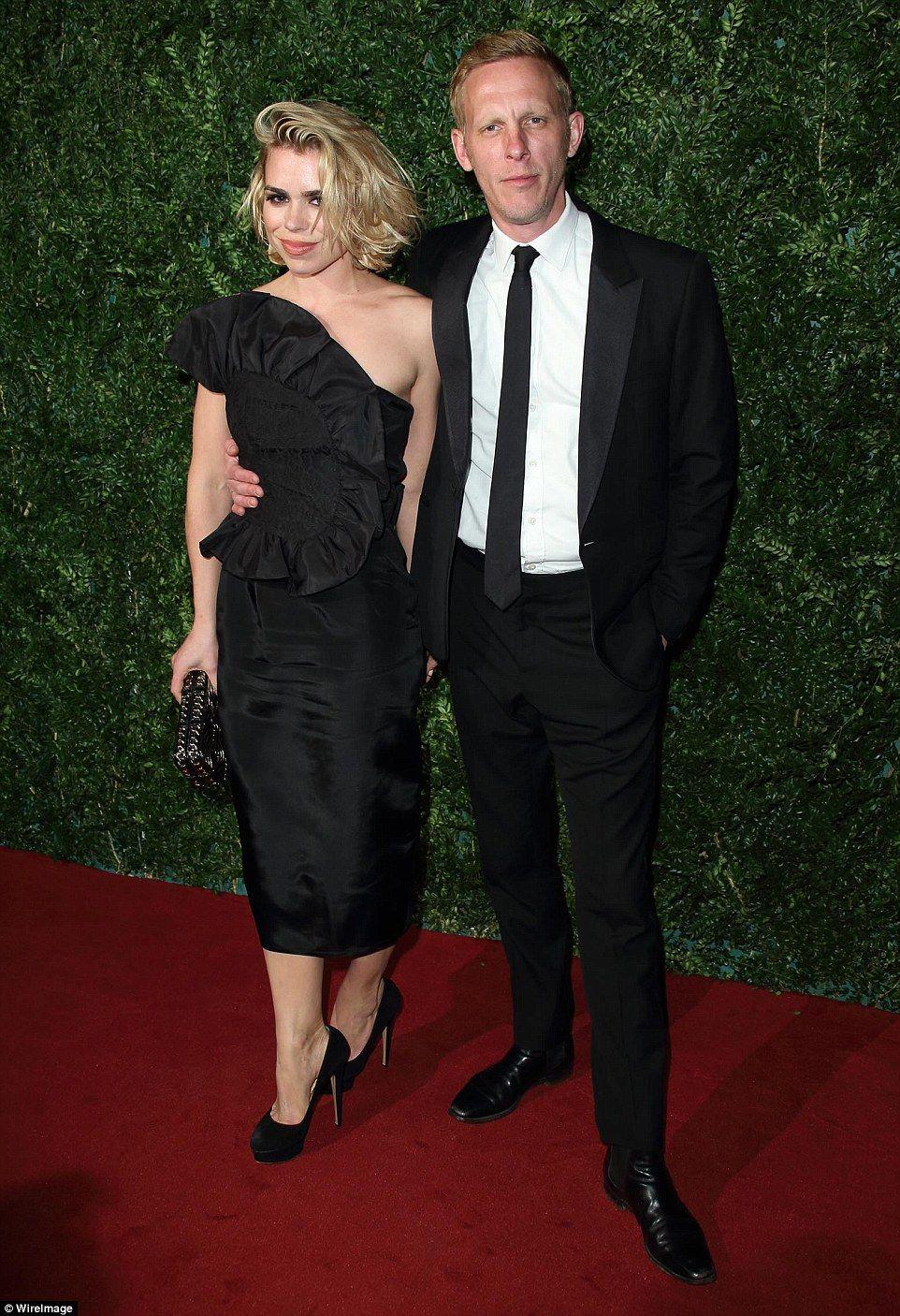 David Beckham holds wife Victoria's hand at Evening