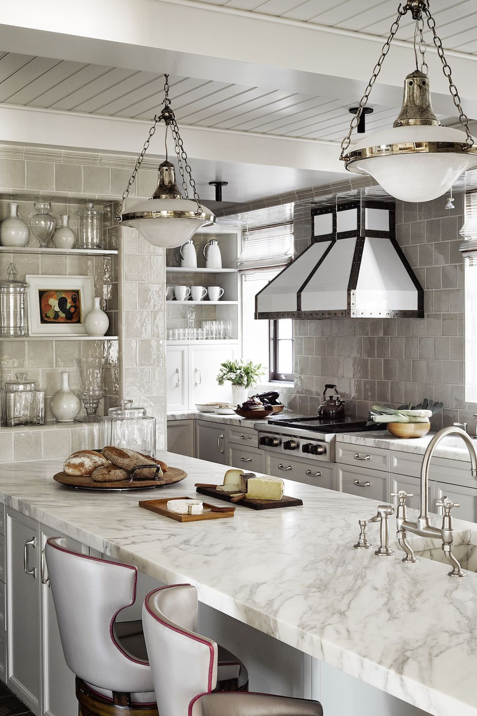A warm gray palette is perfectly executed in this new york city kitchen