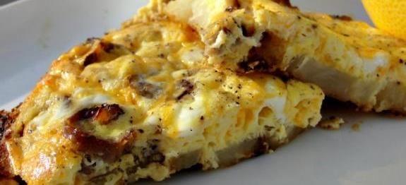 Δες εδώ μια τέλεια συνταγή για ΟΜΕΛΕΤΑ ΜΕ ΠΑΤΑΤΕΣ ΚΑΙ ΛΟΥΚΑΝΙΚΑ, μόνο από τη Nostimada.gr