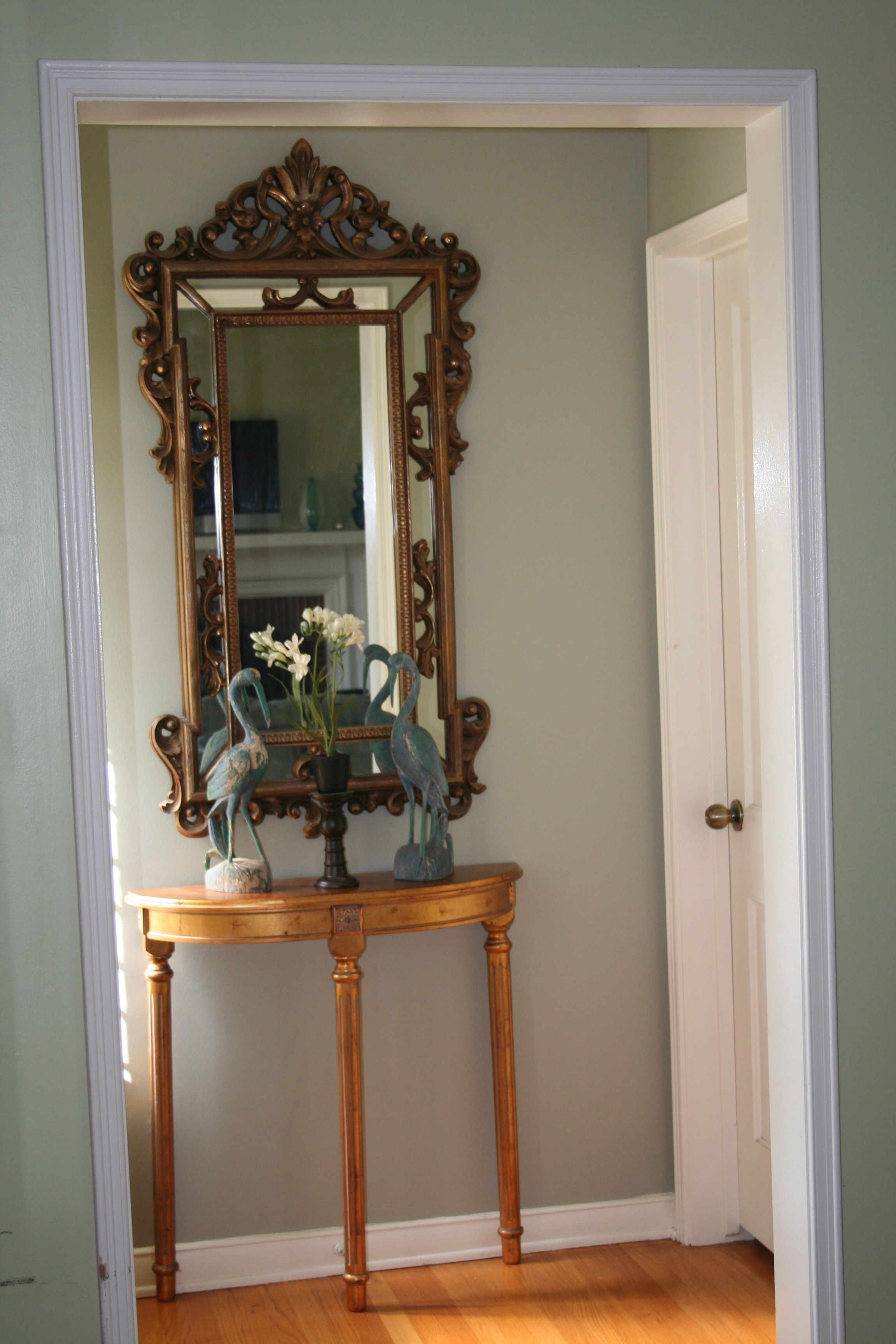 Half Wooden Table With Antique Mirror As Small Space Foyer