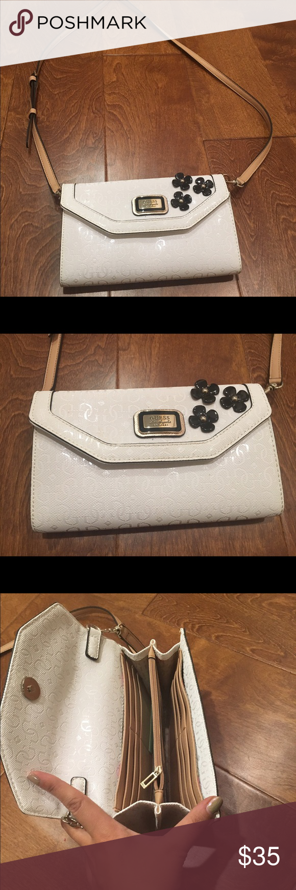 Black and White Guess Messenger Perfect bag for going out or shopping. Lots of compartments for storing credit cards, cash, lipgloss, phone. Cute black and gold flower detail. This cross body wasn't worn more than twice. Like brand new. Guess Bags Crossbody Bags