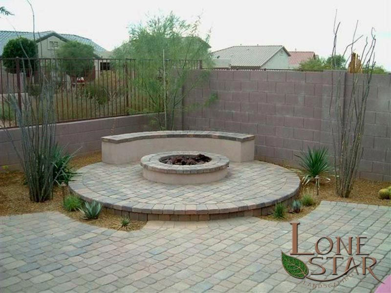 Backyard Patio With Paver Stones Fire Pit And Seating