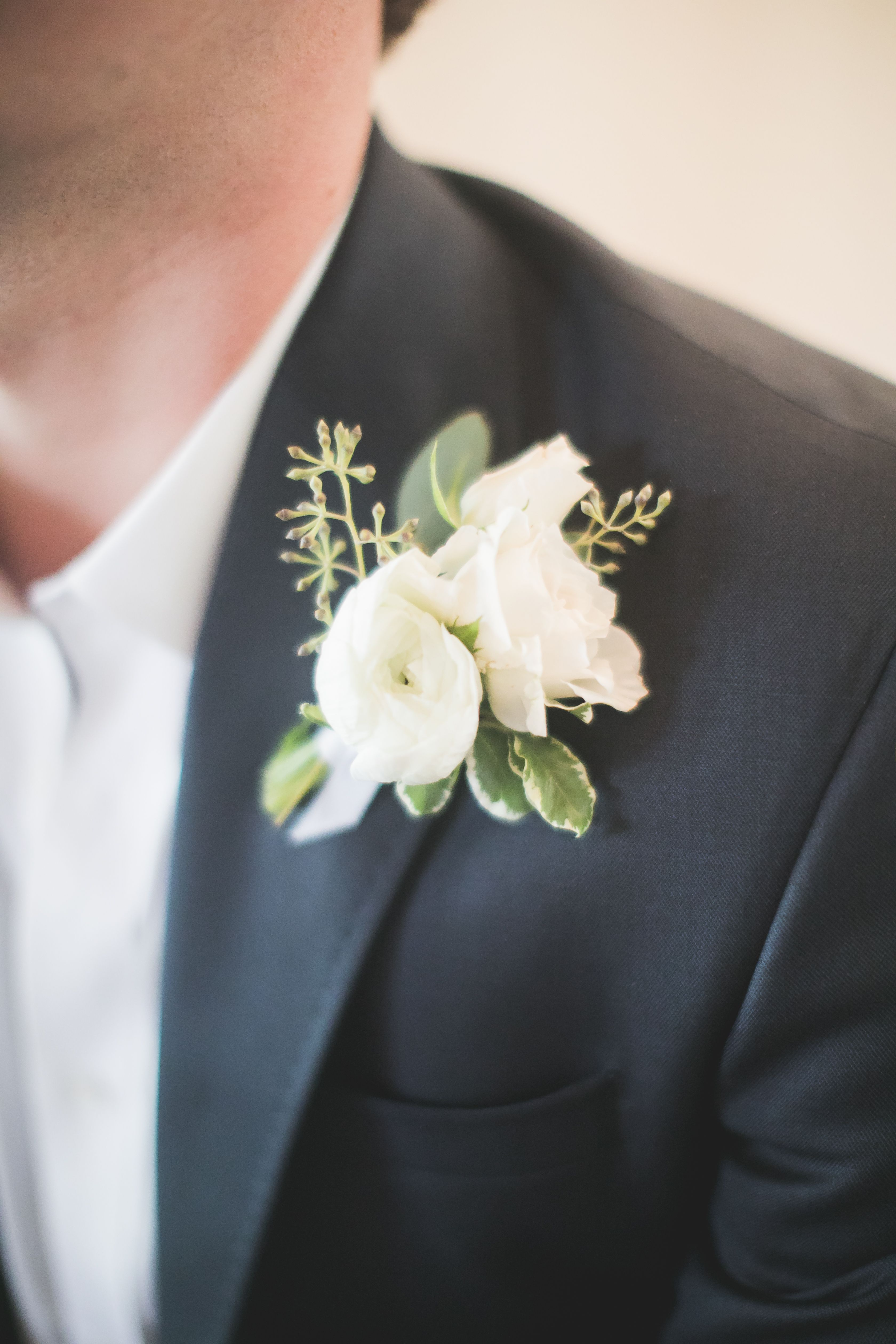 White Ranunculus Boutonniere With Seeded Eucalyptus Ranunculus Boutonniere White Ranunculus Seeded Eucalyptus