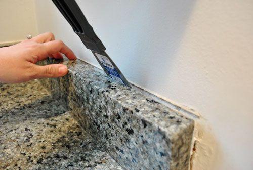 Removing The Side Splash Backsplash From Our Bathroom Sink Diy Backsplash Tile Removal Vanity Backsplash