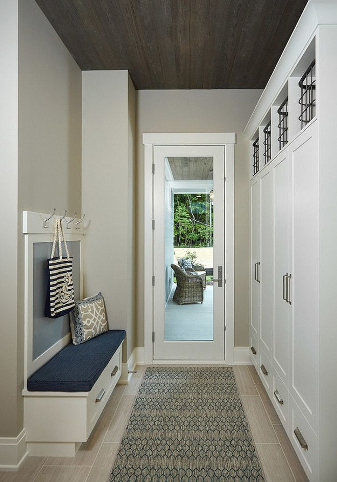 Mudroom With Reclaimed Wood Ceiling Neutral Mudroom With White Cabinets And Reclaimed Wood Ceiling Reclaimed Wood Used On Ce Home Beach Houses For Sale House