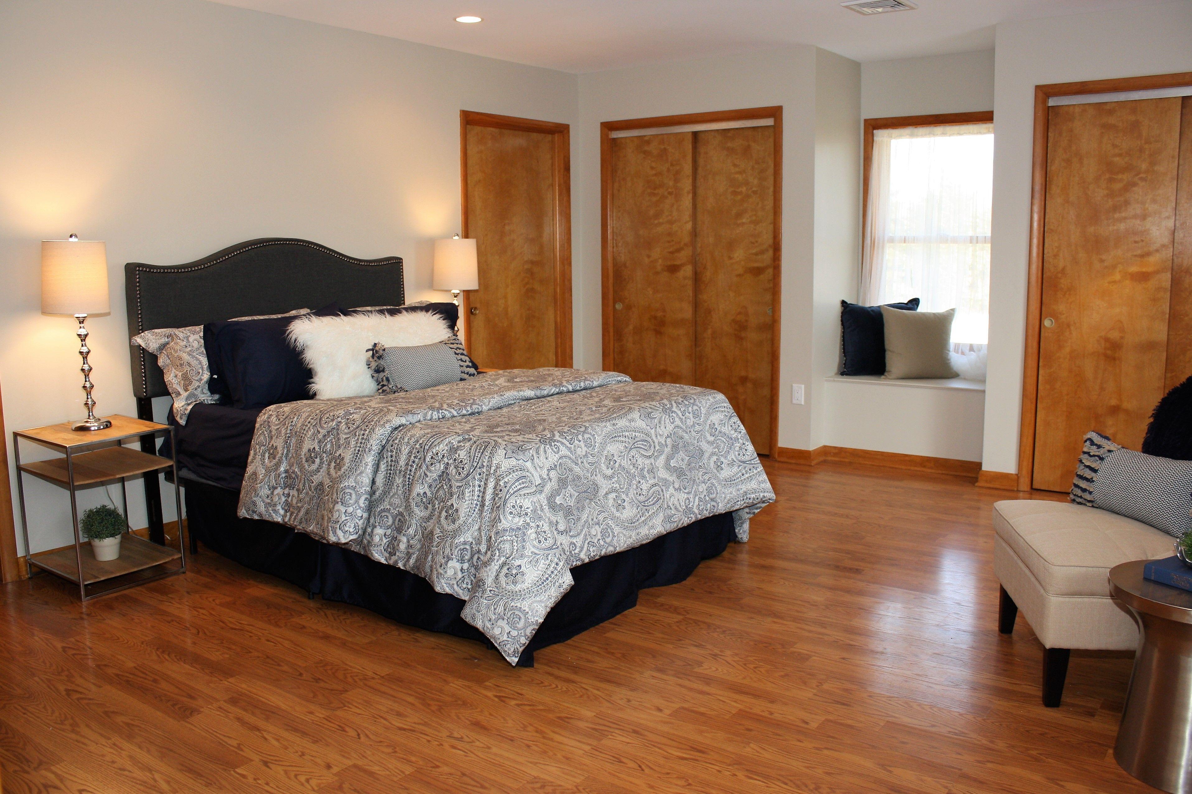 Master bedroom hardwood floors  After Master Bedroom Navy Blue Window Seat Hardwood Floors Dark Gray