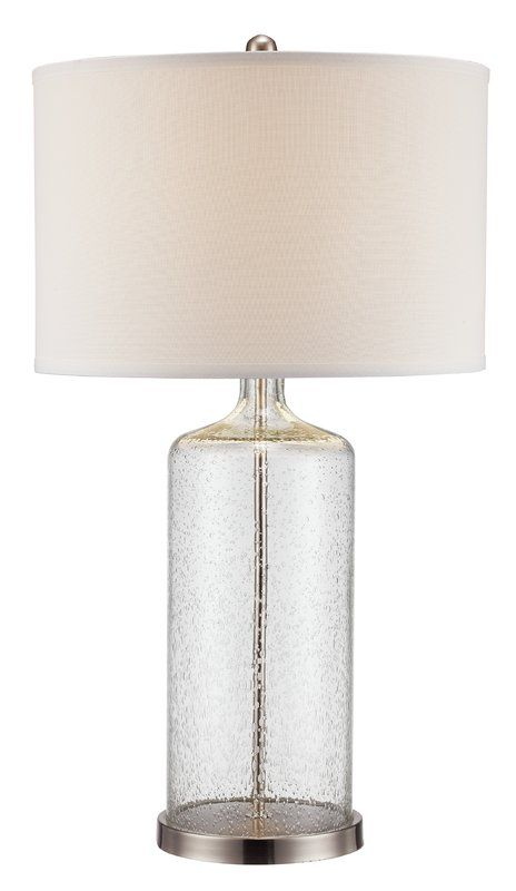 The Beauty Of This Lamp Lies In Its Clear Seeded Glass Body This Stylized Bottle Shaped Glass Lamp Won 39 T Overpower You Lamp Table Lamp Bedside Table Lamps