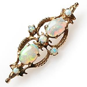 Victorian brooch features beautiful high quality natural Boulder opals. It is about 1 1/2 inches wide, and is crafted of solid 14k yellow gold.