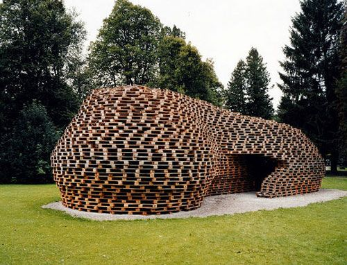 """Unique Shipping Pallets Pavillion in German - Architecture View Wonderful palletecture project. """"In 2005 Matthias Loebermann built a beautiful temporary pavilion out of reclaimed shipping pallets for the Nordic Alpine Skiing World Championship in Oberstdorf, Germany. """" Text from Architecture View."""