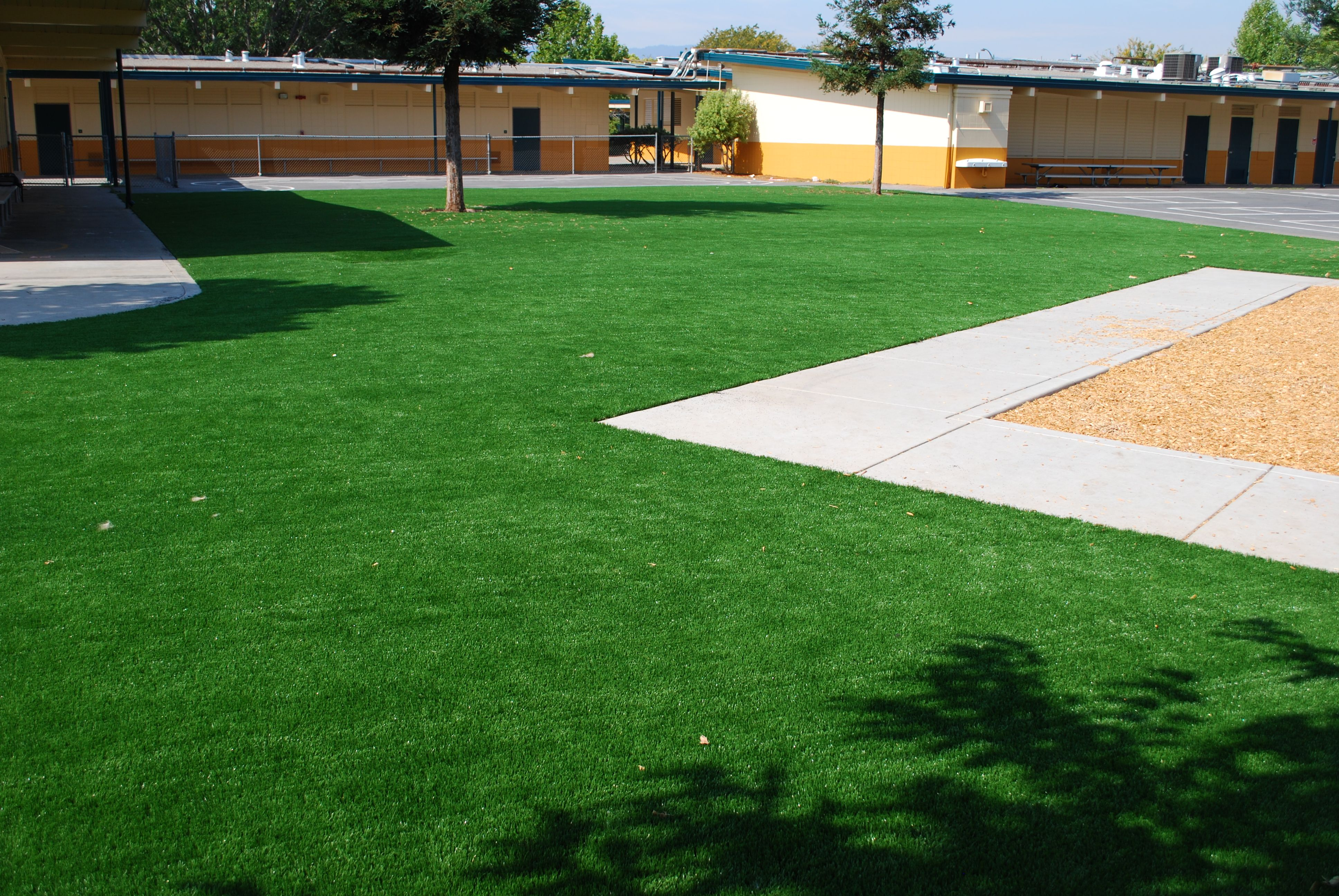 How does artificial turf impact the environment with