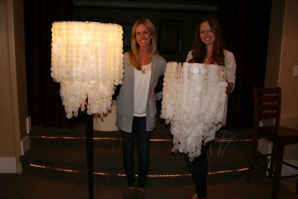 DIY Chandelier- time intensive!  needed: 3-4 rolls of wax paper or paper, 1.5 inch circle punch, frame out of thrift store shade, sewing machine
