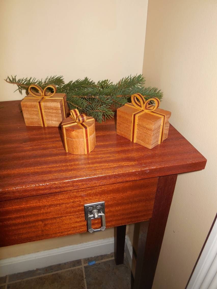 Found out that the gift presentation boxes make great Christmas decorations also. FYI, the table is made out of quarter sawn Sapele.